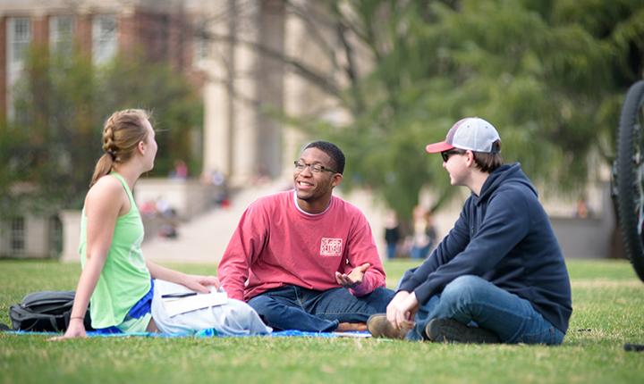 UA students sitting on Quad and conversing