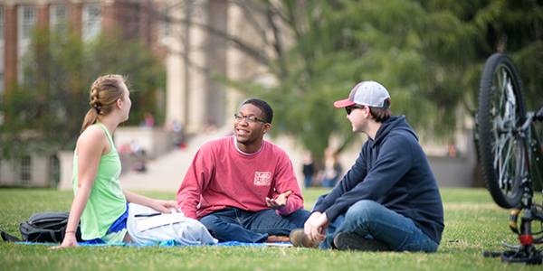 students sitting and talking on the Quad