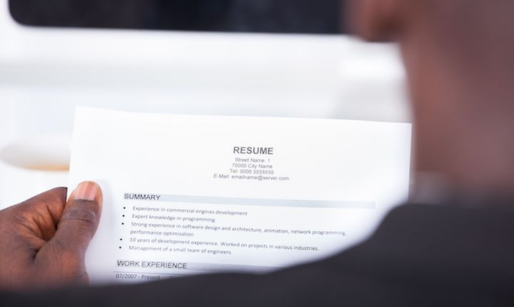 Student holds resume